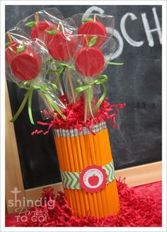 Teacher gift - soup can surrounded by pencils tied on with ribbbon, filled with craft paper shreds and apple-shaped suckers (I think these are fondant-covered Oreo pops with pretzel stems, but probably could order apple-shaped suckers online)