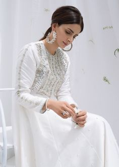 Includes : Shirt : Rawsilk Pants : Rawsilk Dupatta : Organza Product Description: An ivory white pashwas dazzled with a blend of precious metallic stones and bugle beads intricately handcrafted on the Pakistani Formal Dresses, Pakistani Fashion Casual, Pakistani Girl, Pakistani Dress Design, Pakistani Bridal, Pakistani Outfits, Indian Outfits, Indian Fashion, Pakistani White Dress