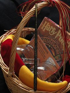 Harry Potter Gift Basket. YES. Harry Potter book, butterbeer recipe, mugs, and a gryffindor scarf.   best stuff