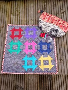 How many swaps have you participated in? One very lucky swap partner from the #rainbowminiswap on Instagram will be getting this brilliant package filled with a lovely mini quilt made by Justine Henshaw​ from Sew Justine Sew and a zippy pouch with some Aurifil​ thread! To see more please visit http://sewjustinesew.blogspot.com/2015/04/mini-quilt-heaven.html