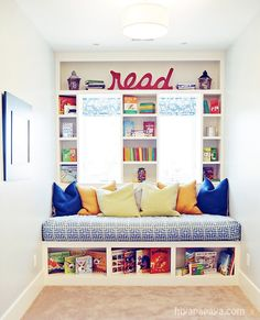 Reading bench with storage underneath and shelving along the windows