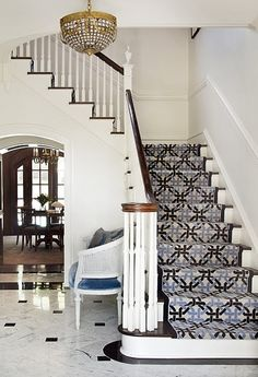 Love the look of carpeted stairs in a bold design.
