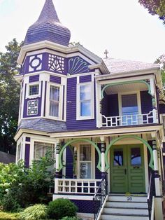 Lilac Victorian House.  I would do yellow instead of green.  and of course, red doors.