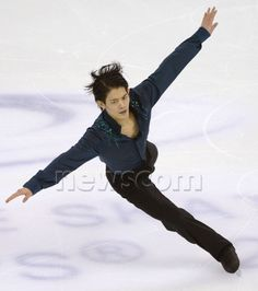 Japan's Takahiko Kozuka performs during the free program of the World Figure Skating Championships on March 28, 2015, in Shanghai. (Kyodo) ==Kyodo