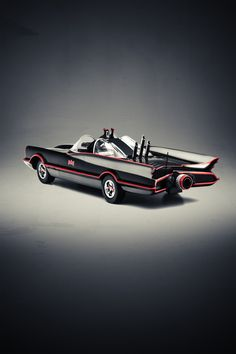 The original TV series Batmobile, recreated in poster style.