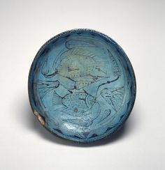 Ancient Egyptian faience dish featuring a blue lotus and tilapia fish, both symbols of fertility and life. (Walters Museum)