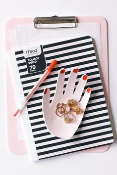 Follow these simple instructions to make a beautiful DIY clay hand ring dish that's both beautiful and functional atop your desk.