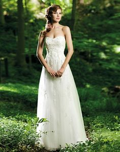 3661    STORE LOCATOR           Shown in Ivory        Strapless sweetheart neckline satin with lace appliques and empire cut with mermaid under skirt with tulle cage over skirt with flowering appliques, buttons down the back zipper with chapel train
