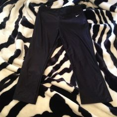 Black Nike Dri-Fit capris Brand new and without the tags. Thought they would fit me. They're too big. Apparently I'm a xsmall. Nike Pants Capris