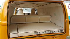 Late bay 1979 VW Campervan. This photo captures the rear rock n roll bed spare wheel infill. You also get a great view of those bespoke side and roof panels. A challenging interior to create, but worth the praise we received from a very happy customer.