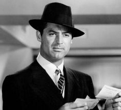 Men don't wear fedoras anymore and they totally should - a la Cary Grant.