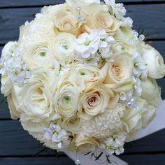 Happy belated #weddinganniversary to our bride Laken!  Ranunculus are one of my favorite flowers. What's yours?  #thefloralcottageflorist #throwbackthursday #tbt #ascensionweddings #batonrougeweddings #weddingbouquets #ranunculus #bridalbouquet #bridalflowers #nolaweddings #houmashousewedding #favoritebouquetever