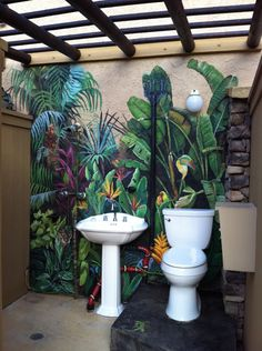 outdoor bathroom mural with glow in the dark eyes on all of the hidden animals