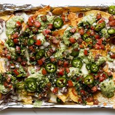 Loaded black bean nachos with red and green salsa... You might have more of the salsas than you need; serve them on the side for dipping.