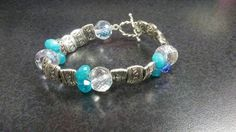 Check out this item in my Etsy shop https://www.etsy.com/listing/268571357/a-few-blue-beads-bracelet