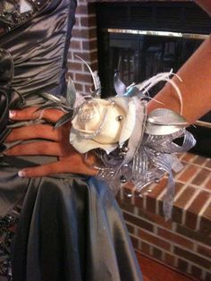 Creative ideas for prom flowers- silver dipped and sprayed with jewelry and feather embellishment!