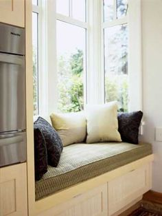 Window seat in the kitchen...I want one of these so so bad! Such a great place to talk to each other and our kids!