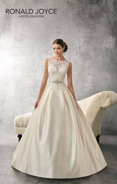 AUDREY An exquisite lace dropped waist bodice with a boat neckline and  plunge back on a f36936a45
