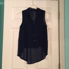 Navy blue high-low top Sleeveless. Paired great with white jeans! I think that's the right brand. Hard to read the cursive. Kaii Tops