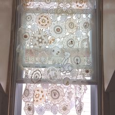 I finally finished my vintage doily curtain! I spent MANY hours over many days on it, but it was so worth it. I want to do a little tweaking here and there, mainly on the bottom half to add a few more pieces on the edges, but for now, it's done.