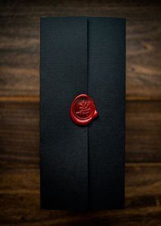 Dramatic wedding invitation by Penn & Paperie - a black pocket folder with red wax seal. See more here: http://pennandpaperie.com/invitations/#/noire/