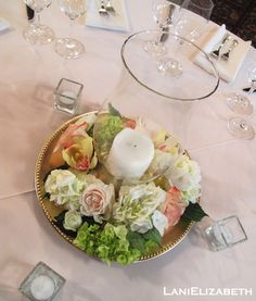hurricane candle centerpiece with flowers