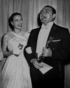 "Two Hollywood icons share a laugh as the late Ernest Borgnine appears with presenter Grace Kelly and his Best Actor Oscar (for ""Marty"") backstage at the 28th Academy Awards."