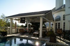 Solid Patio Cover with pitched roof. Love columns