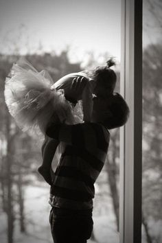 Ry and I each hold a girl and do this pose in their tutus!