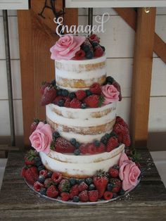 Semi Naked Vanilla cake with strawberry jam and buttercream. The roses are hand made with fondant.