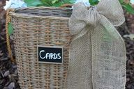"""I love baskets and this is such a neat idea, the burlap bow just completes the whole look for this card """"box""""."""