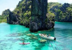Palawan, Philippines - Known for its crystal clear, emerald-hued waters, Palawan in The Philippines is one of the world's most exotic locations. A rush of high end resorts in the north called El Nido, Palawan puts Philippines on the map to travelers. Amazing Destinations, Travel Destinations, Travel Tours, Travel Guide, Cool Places To Visit, Places To Travel, Beautiful Islands, Beautiful Places, Places