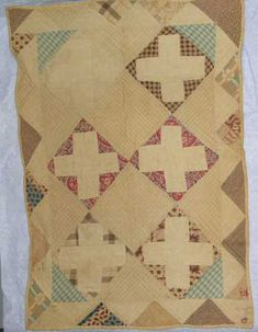"""Criss Cross Doll Quilt, DAR Museum, 14"""" x 20.5""""; very worn, fading, c. 1865, six patterned blocks, two plain blocks, four half plain blocks, & 4 quartered plain blocks; block size: 5.5"""" x 5/5""""; blocks on point, pieced saw tooth border (abt 2"""" wide), backing is beige or tan cotton, binding - back turned to front, less than 1/2"""" wide; thin cotton batting, quilted with white thread 7-9 stitches per inch in single parallel lines & grid diamond, teaching or learning sample."""