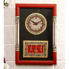 Its on Sale!  Black & Red Warli Painted & Dhokra craft fusion Wall Clock - This clock fuses two art forms, the Warli tribal art from Maharashtra and the Dhokra or lost wax casting from Bastar, to augment its appeal. It is mounted on a wooden board and painted in variegated hues of crimson, black, peach and gold . All this makes this clock the perfect one for your drawing room.   Buy from our #webboutique.  #wallclock #worli #warli #dhokra #clock #homedecor #walldecor #rajasthan
