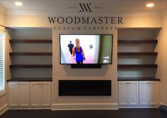 Woodmaster Woodworks custom built ins. Stained shelves and paint grade cabinets.