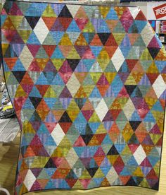 Marcia Derse's booth at Quilt Market.  The quilt features Marcia's fabrics.