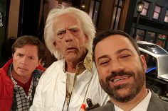 Jimmy Kimmel takes a selfie with Marty McFly and Doc Emmett Brown after they travel from the 1980s to the middle of his show on October 21, 2015