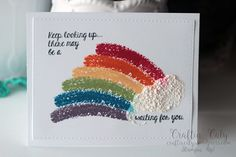 Handmade rainbow card that uses the Snow Marker to create that fluffy cloud.