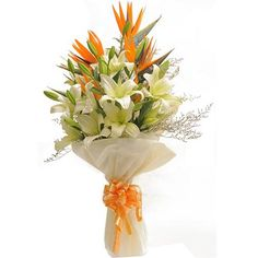 Exotic hand tied bouquet of 8 White Lilies & 3 Bird of Paradise wrapped in imported paper packing.