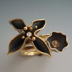 Ring | Anne Marie Cianciolo. Oxidized sterling silver, 18k yellow gold, diamond, sapphire