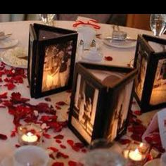 Candlelit wedding picture centerpieces for the reception! <3