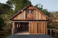 A California boat house is easy to find with the help of a galvanized barn light.