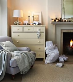 Create a cosy home with soft lighting and lots of soft throws