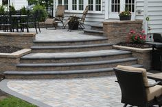 Multi Level Patio with walls and bull nose Pavers using Techo Bloc Designed and installed by R&R Caddick Design Front Yard Patio, Patio Wall, Backyard Patio, Backyard Ideas, Pergola Patio, Patio Area Ideas, Stone Backyard, Backyard Decorations, Terrace Ideas