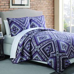 This quilt and sham set will look stunning on your bed. This Aztec-inspired Saguro set features a bold diamond pattern that will dress up your room beautifully.