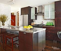 A large kitchen island provides plenty of prep space, which becomes even more hardworking with the addition of a sink./
