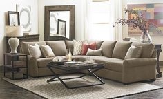 Leather Scarborough L-Shaped Sectional by Bassett Furniture features deeper seating for a comfortable, relaxing and luxurious experience.