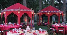 raj tents, red ottoman tents, outdoor wedding reception inspiration, red decor inspiration