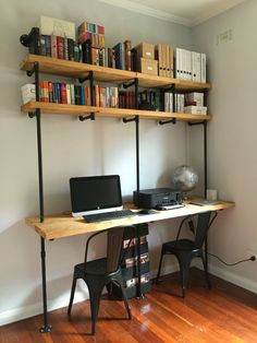 Industrial desk and bookshelf made with cast iron pipes.