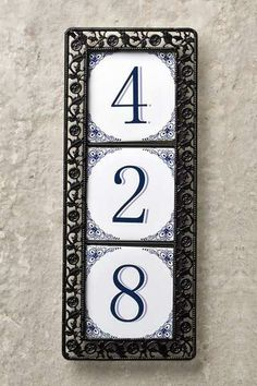 Delft-style decoration encircles these house numbers, set inside intricate metalwork. Cost: about $4 per tile; about $5.25 for the frame; Dutch Gift Outlet. | Photo: Andrew McCaul | thisoldhouse.com